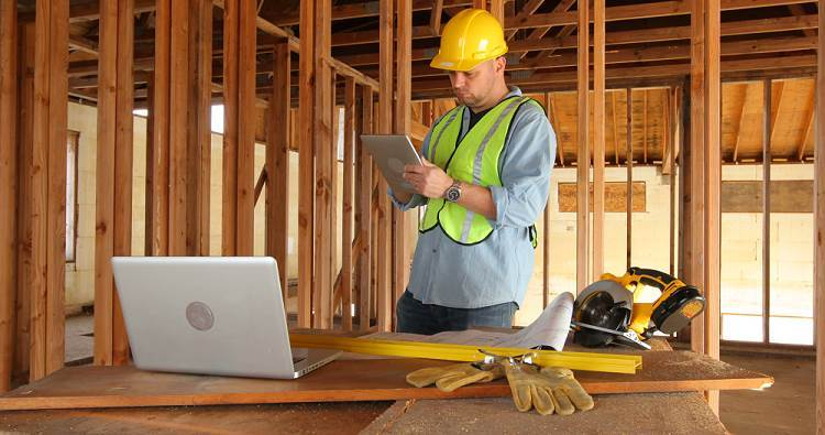 construction-worker-using-digital-tablet-and-laptop-computer_v1zlgxh6__F0000.png